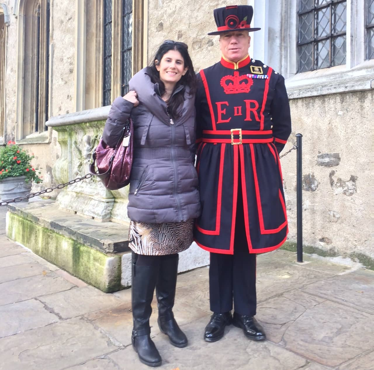 Anisa and a Beefeater at the Tower of London