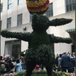 "easter landscaping with text overlay ""NYC Easter Bonnet Parade includes video"""