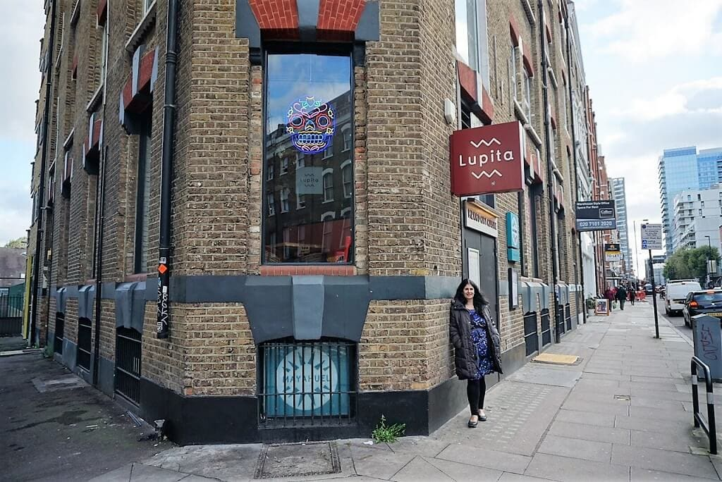 Anisa in front of the Lupita mexican restaurant by Liverpool Street in London