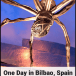 sculpture by the guggenheim museum in bilbao spain with text - one day in bilbao spain
