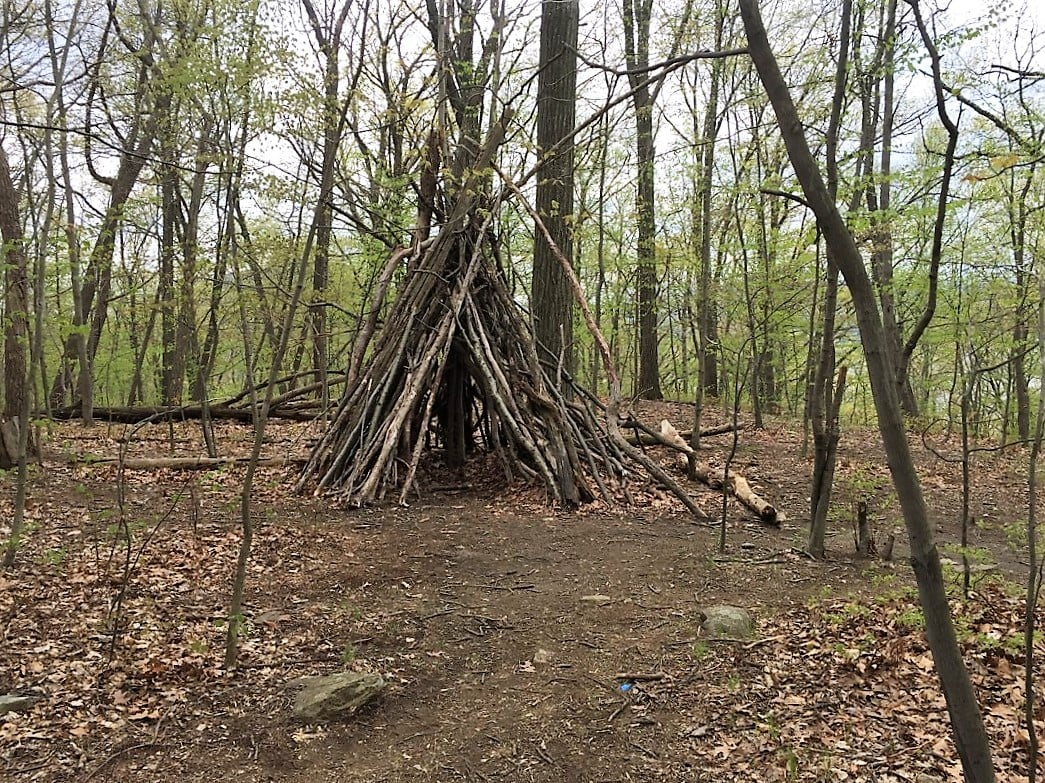 teepee made out of branches along the breakneck ridge trail