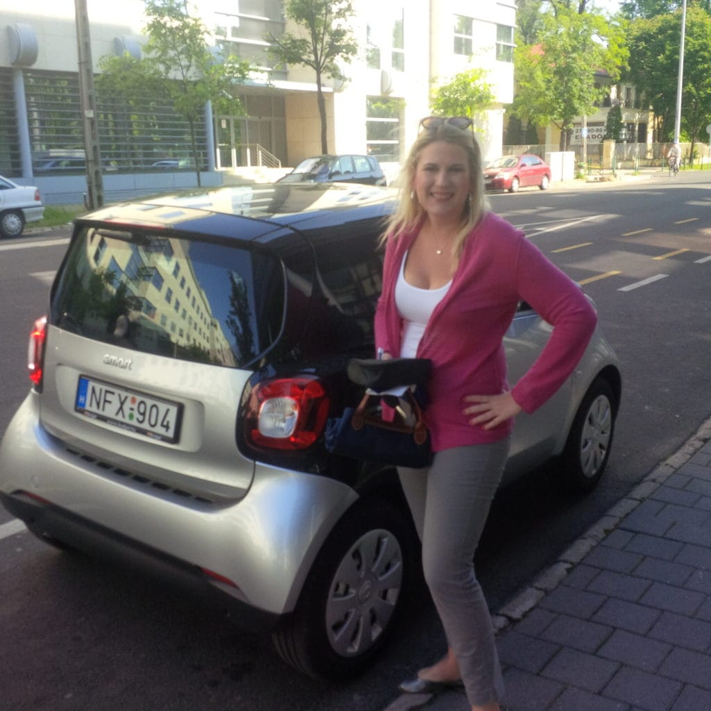 Katherine with her smart car rental in Europe