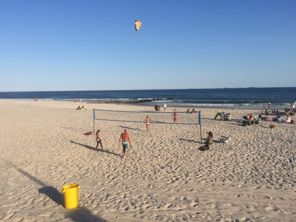 A game of beach volleyball in Long Beach