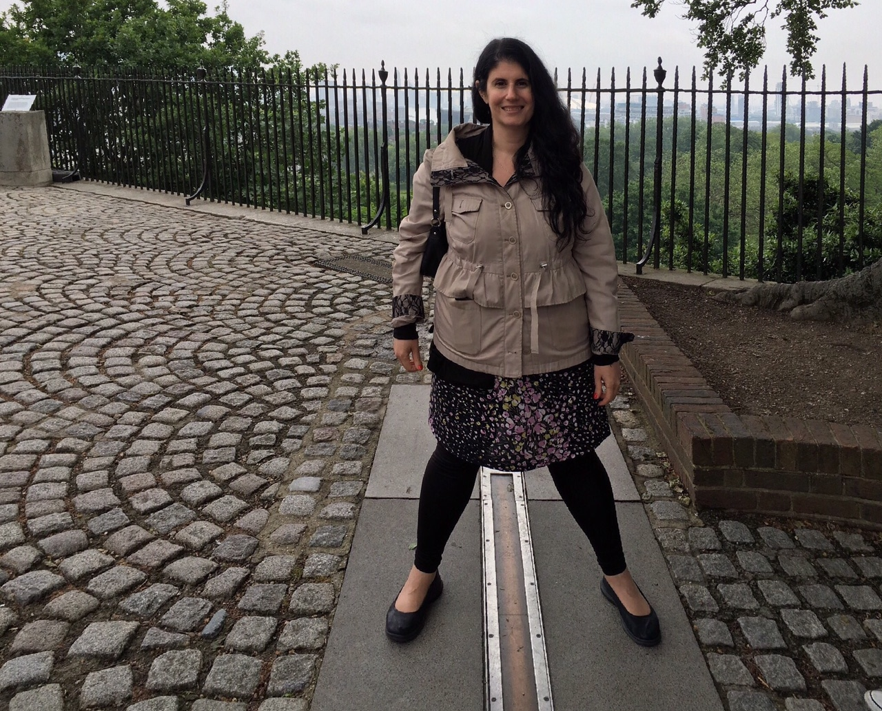Anisa standing over the Prime Meridian at the Royal Greenwich Observatory. One foot in the Eastern Hemisphere and one foot in the Western Hemisphere.