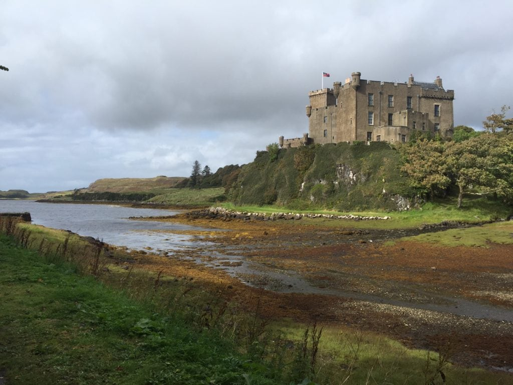 Dunvegan Castle is built on a hill over looking the water. - Dunvegan Castle Photos - Two Traveling Texans