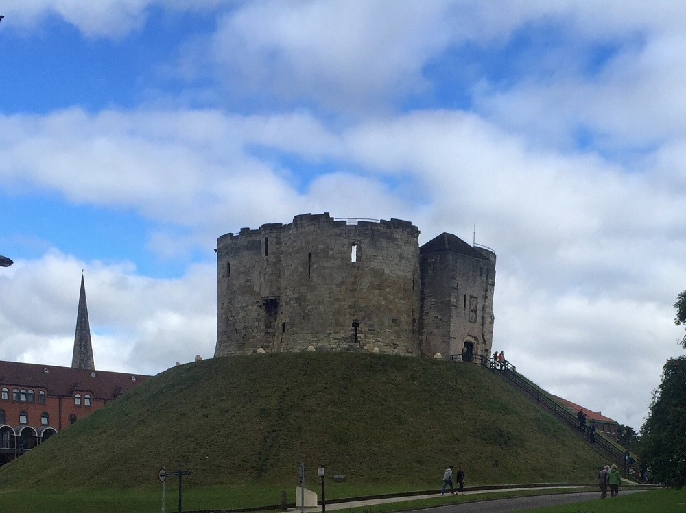 "You can't miss Clifford's Tower perched on top of the hill. - ""York: Five Must See Historic Sites"" - Two Traveling Texans"