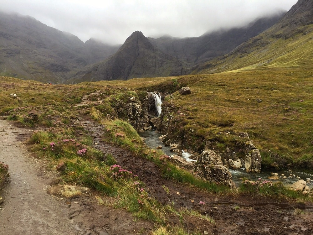 "The weather may have been disappointing but the Fairy Pools were still beautiful. - ""The Magical Fairy Pools in Isle of Skye, Scotland"" - Two Traveling Texans"