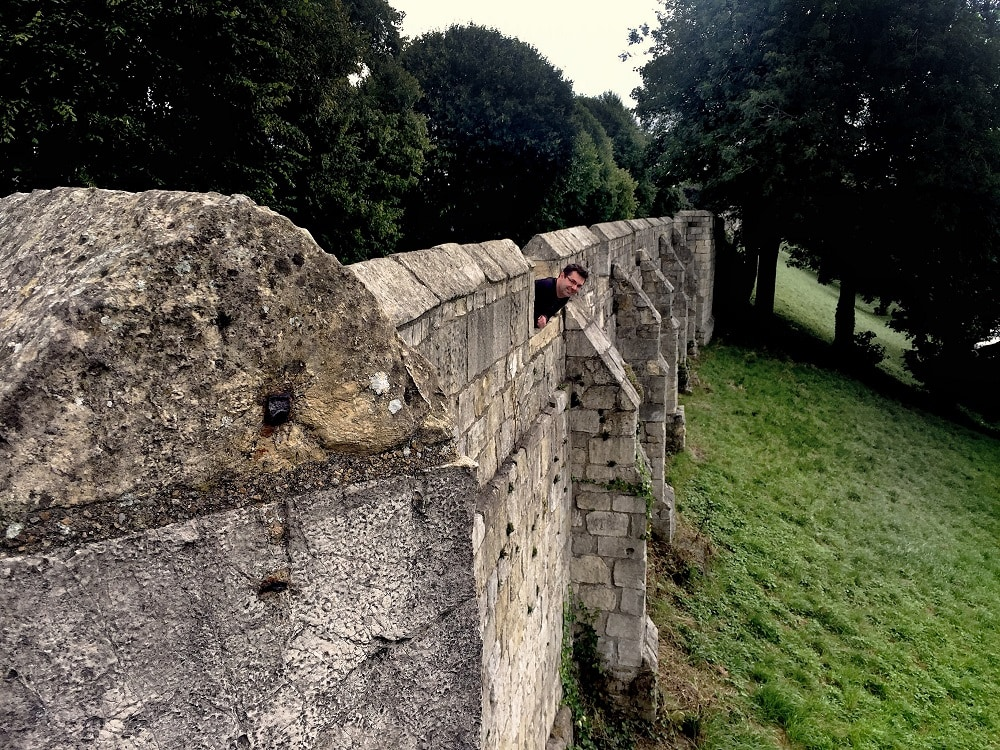 "Russell enjoying the York Wall Walk. - ""York: Five Must See Historic Sites"" - Two Traveling Texans"