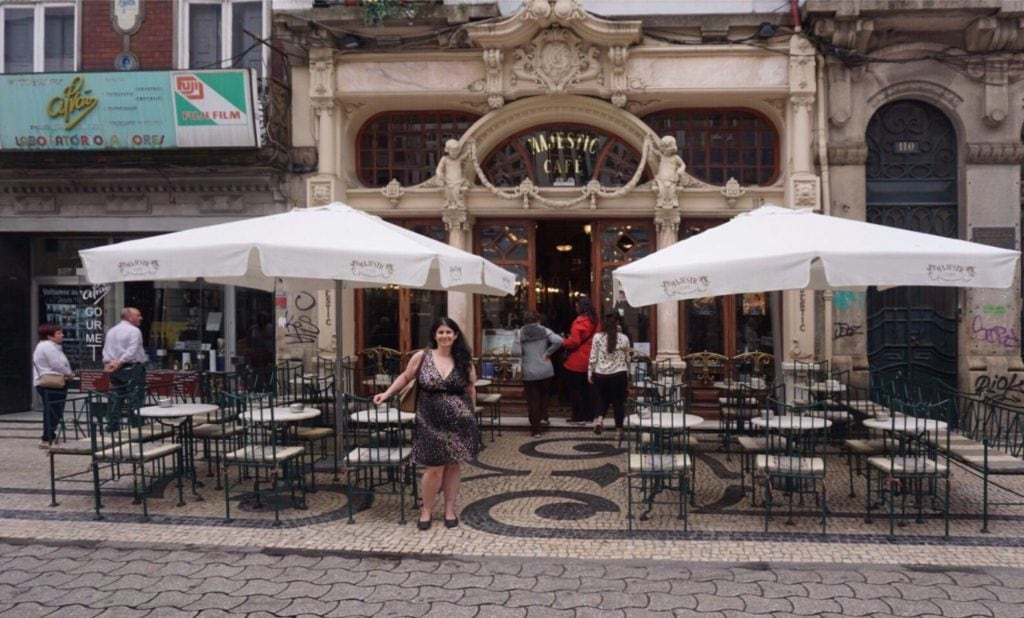 "Anisa in front of the Majestic Cafe in Porto. - ""Three Harry Potter Porto Sites to See"" - Two Traveling Texans"