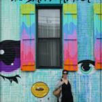 anisa in front of street art in brooklyn