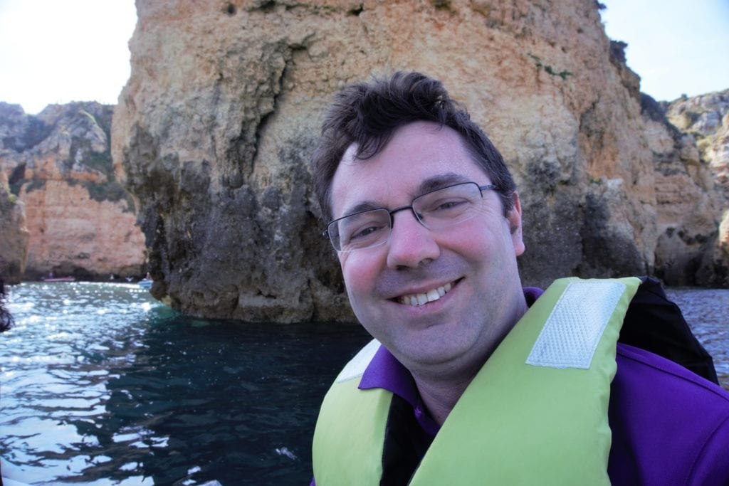 """Russell on the smaller boat as we headed to the caves. - """"Algarve Caves By Boat with Bom Dia"""" - Two Traveling Texans"""