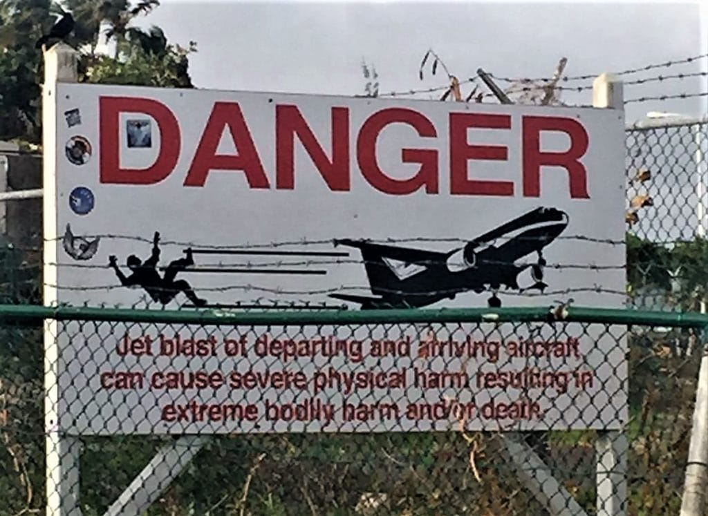 "The warning sign that so many beach goers disregard! - ""Maho Bay: Plane Spotting in St. Maarten"" - Two Traveling Texans"