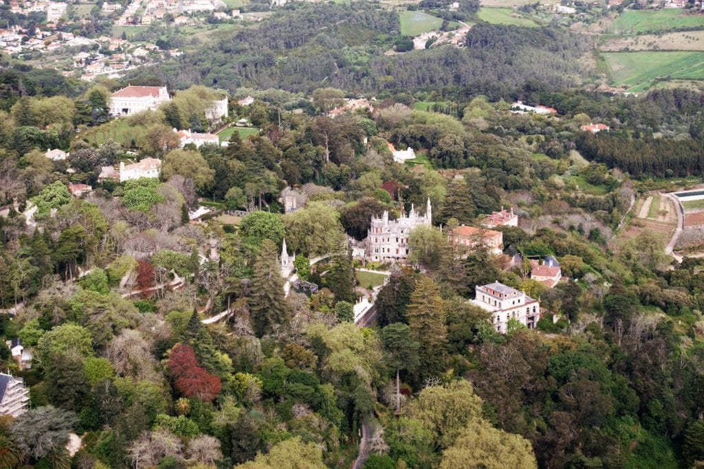 "From the Moorish Castle, you have a great view of some of the other attractions in Sintra including the Quinta de Regaleira in the center of this shot. - ""Plan Your Own Sintra Tour"" - Two Traveling Texans"