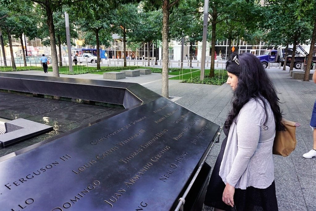 Anisa taking time to read the names at the memorial.