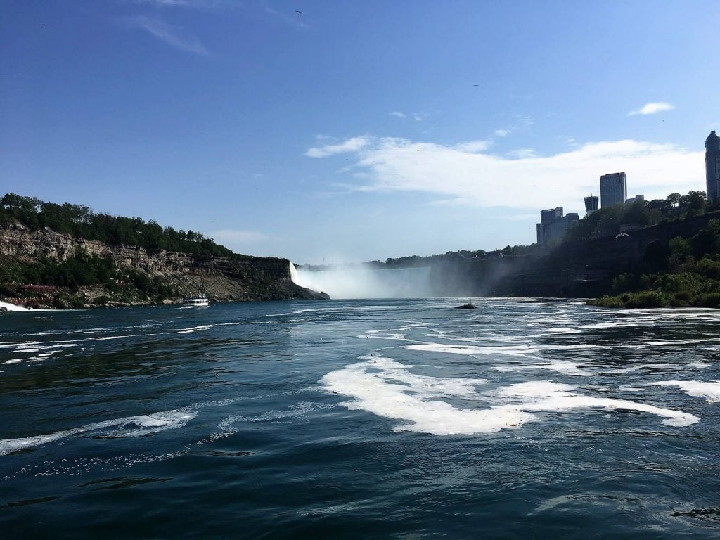 "You can see the river looks pretty calm heading towards the Horseshoe Falls. - ""Hornblower Niagara Cruises Vs Maid of the Mist"" - Two Traveling Texans"