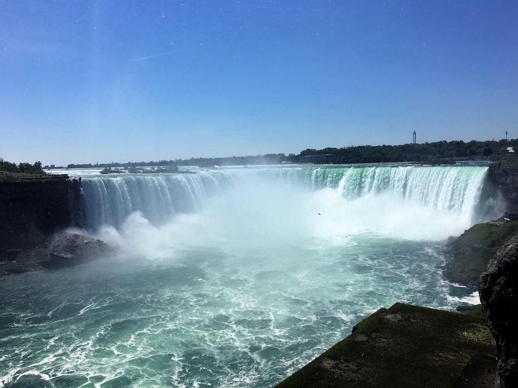 "The Horseshoe Falls is where the boat ride really gets intense! - - ""Hornblower Niagara Cruises Vs Maid of the Mist"" - Two Traveling Texans"
