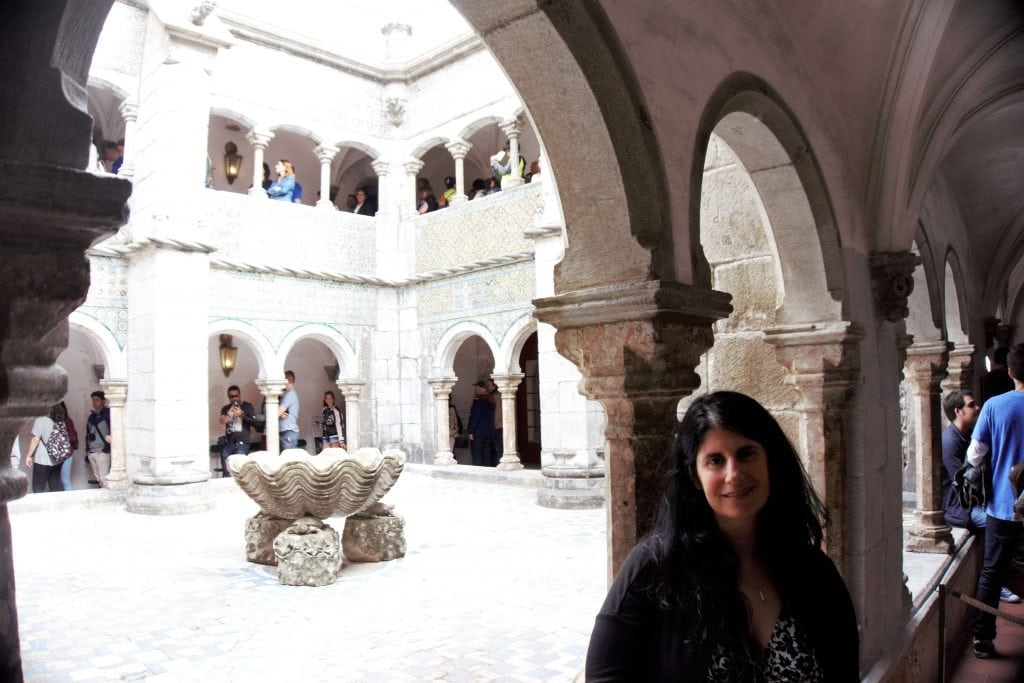 "Anisa inside the courtyard of Pena Palace. - ""Pena Palace: Sintra's Fairytale Castle"" - Two Traveling Texans"