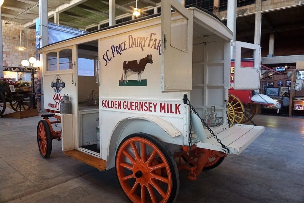"One of the milk delivery wagons on display inside the Texas Cowboys Hall of Fame. - ""Fort Worth Stockyards: Learn About the Old West"" - Two Traveling Texans"