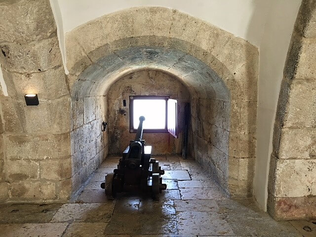"One of the cannons inside Belem Tower. - ""The Best Things to Do in Belem (Lisbon)"" - Two Traveling Texans"