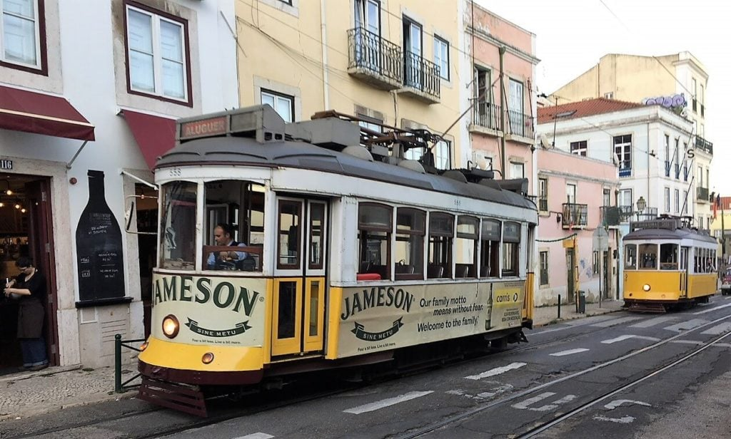 "The iconic trams in Lisbon - ""Our Amazing Portugal Road Trip Itinerary"" - Two Traveling Texans"