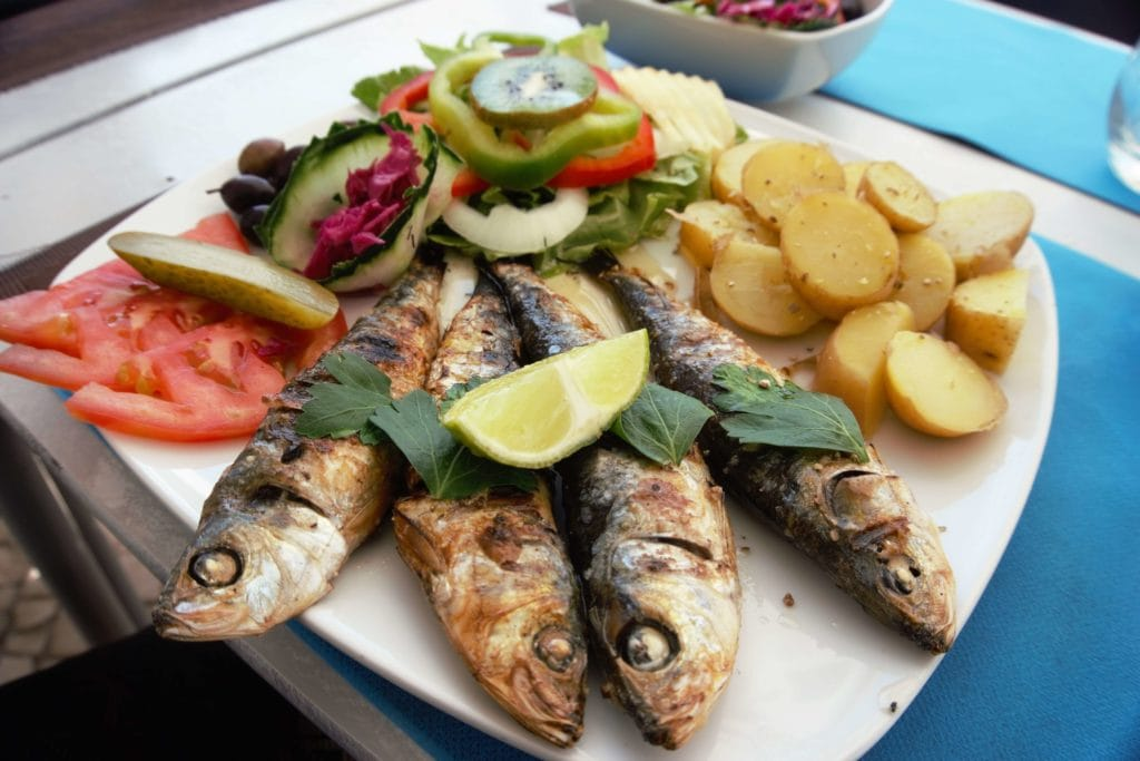 "The food in Portugal (and especially the Algarve) was delicious! I really love the sardines.- ""Our Amazing Portugal Road Trip Itinerary"" - Two Traveling Texans"
