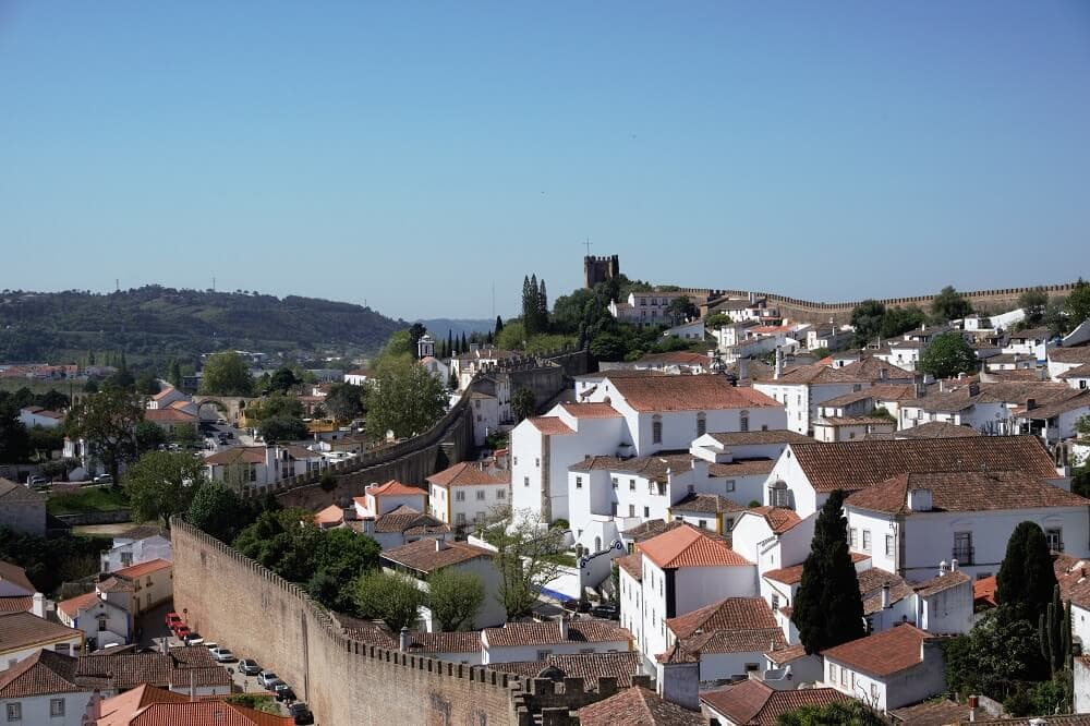 "A view over Obidos from the city wall walk. - ""Our Amazing Portugal Road Trip Itinerary"" - Two Traveling Texans"