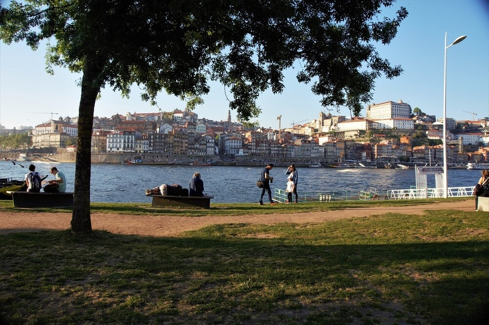 "Hanging out along the Douro River in Porto- ""Our Amazing Portugal Road Trip Itinerary"" - Two Traveling Texans"