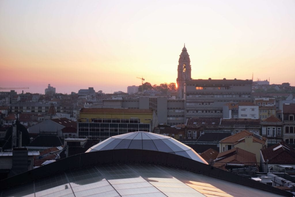 "Sunset over Porto- ""Our Amazing Portugal Road Trip Itinerary"" - Two Traveling Texans"