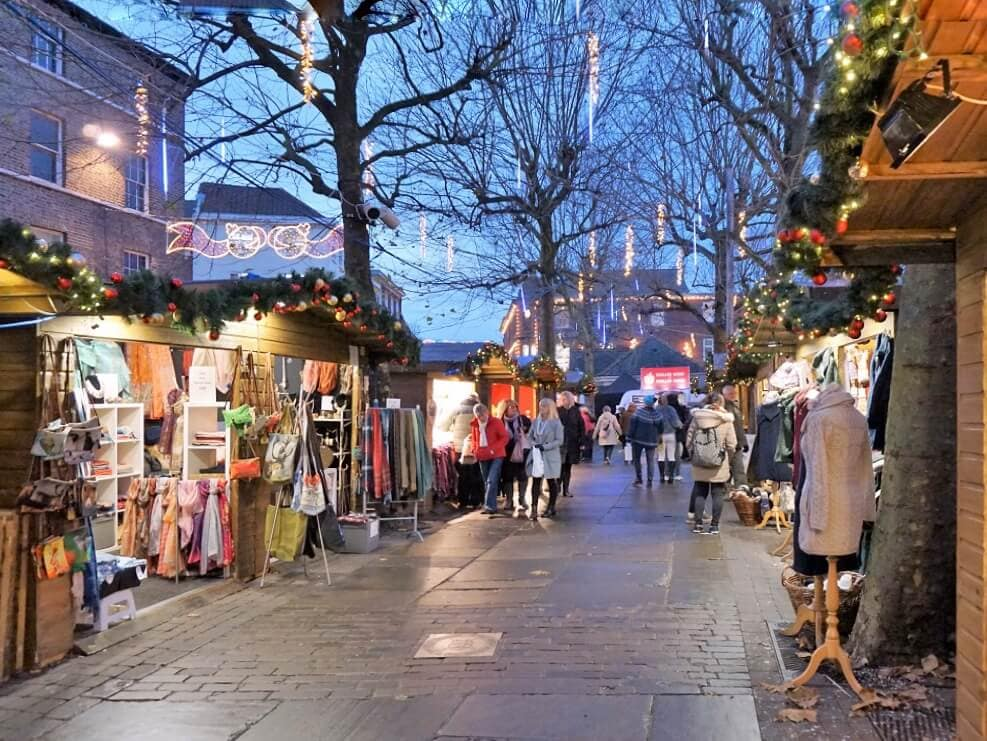 "As the sun goes down, the market gets more beautiful. - ""St. Nicholas Fair York Christmas Market Guide"" - Two Traveling Texans"