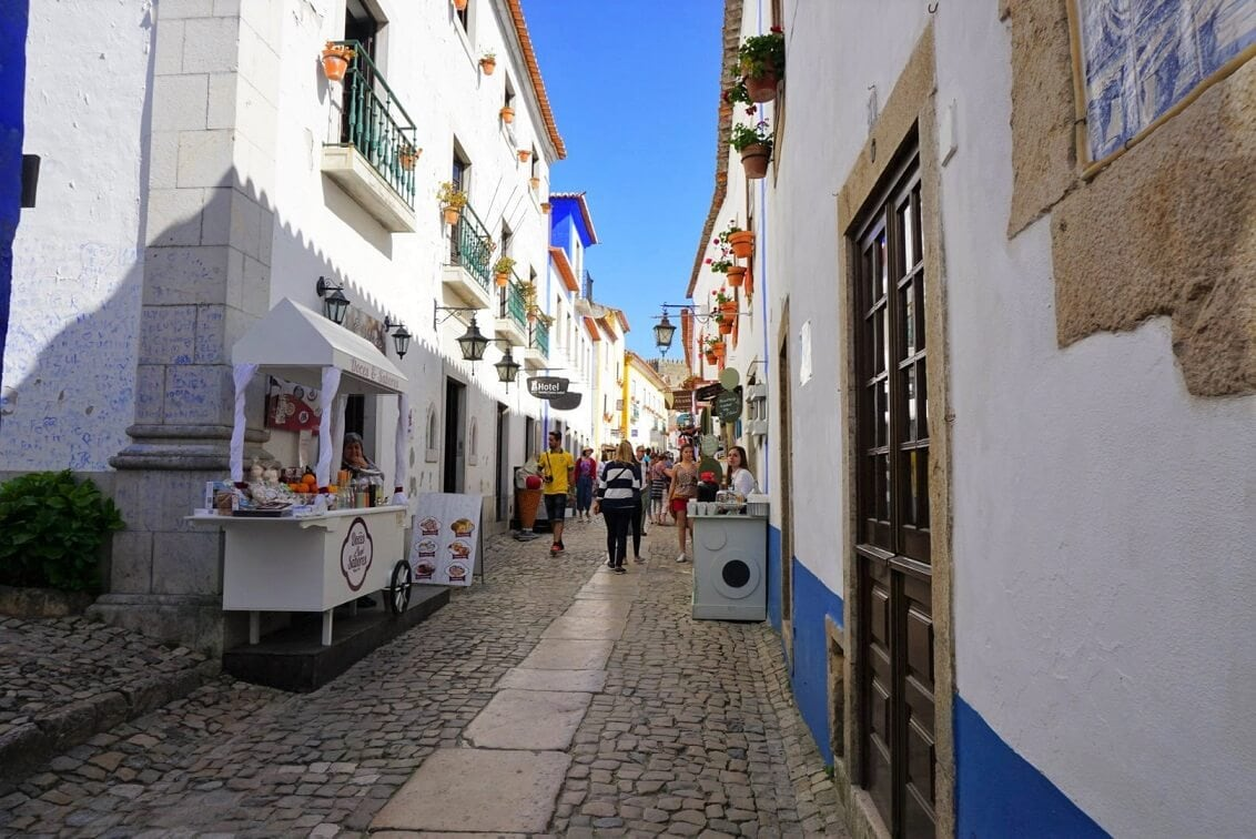 The main street is full of shops and places that will sell you Ginja. -