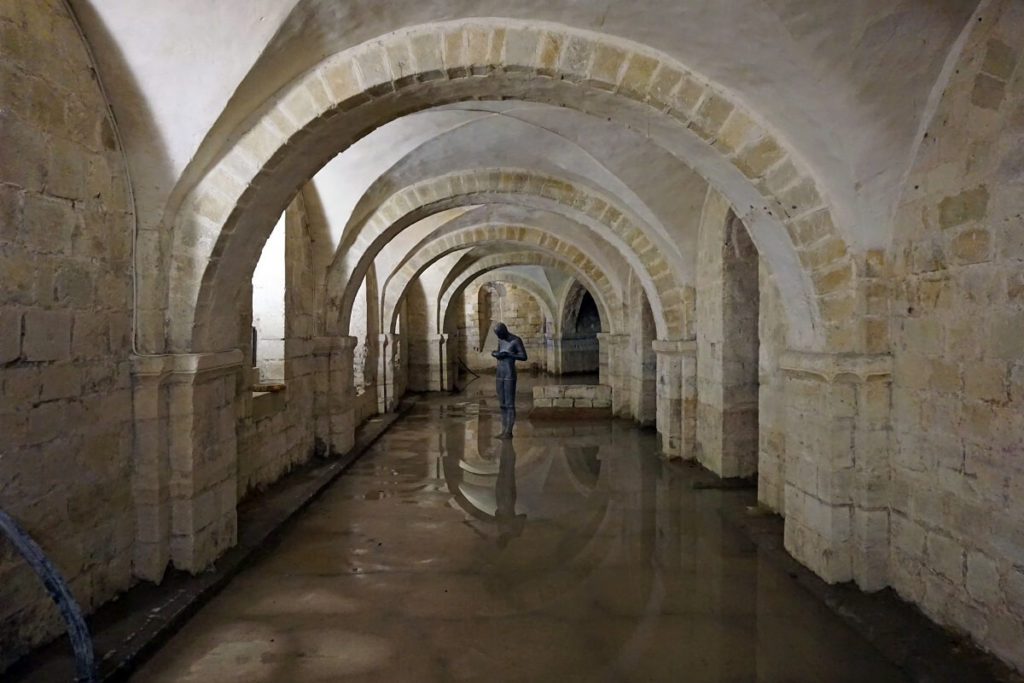 "The Winchester Cathedral Crypt with Anthony Gormley's Sculpture - ""Discovering Historic Winchester England"" - Two Traveling Texans"