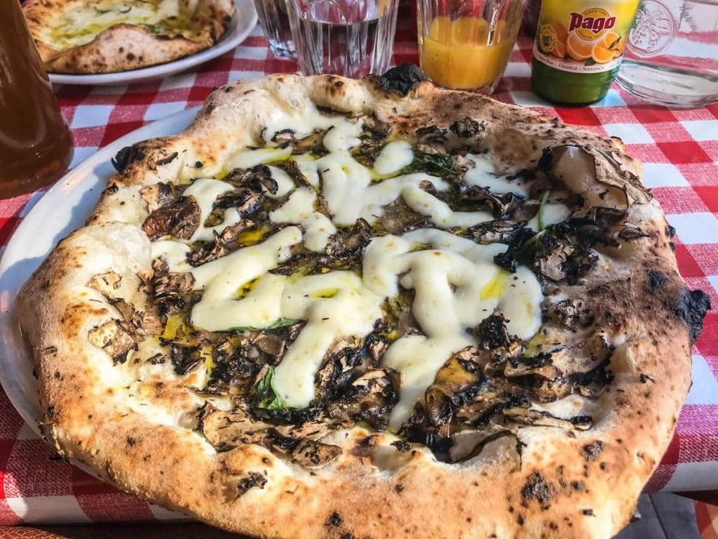 If you like mushrooms, you will love this pizza from Pizza Pilgrims. - The Best Restaurants in Shoreditch - Two Traveling Texans