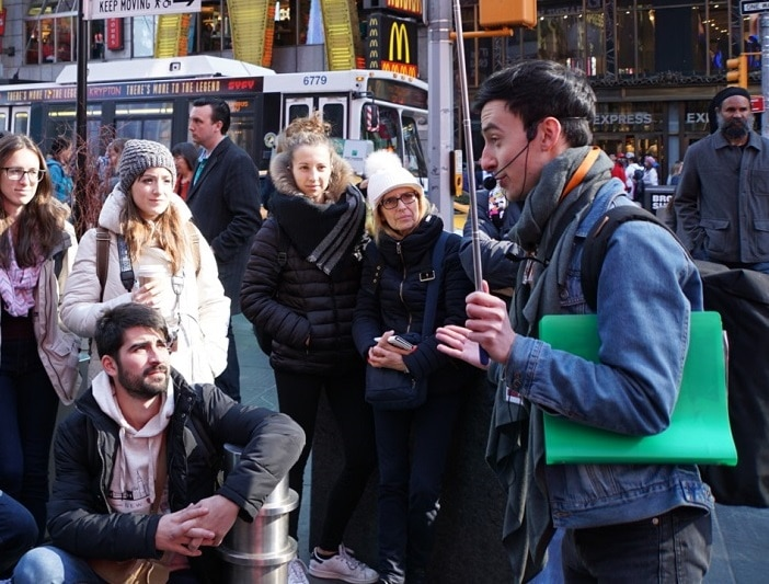 """Filip shares some interesting stories about Times Square. """"Inside Broadway Tour: Discover NYC's Theater District"""" - Two Traveling Texans"""