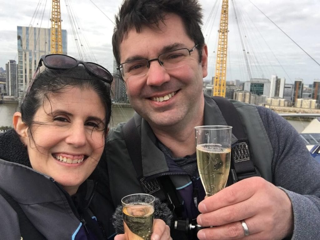 Celebrating with champagne on top of The O2. - Climb The O2: A London Icon - Two Traveling Texans