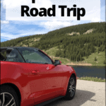 "sports car on the road with text overlay ""how to prepare for a road trip"""