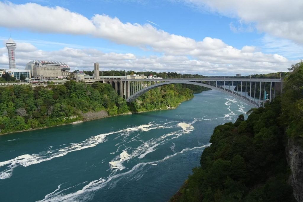 You can cross the border of the United States and Canada by walking across the Rainbow Bridge. -Tips for Visiting Niagara Falls - Two Traveling Texans