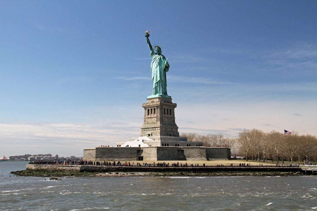 "The Statue of Liberty stands proud in the New York Harbor. - - ""Tips for Visiting New York City For the First Time"" - Two Traveling Texans"