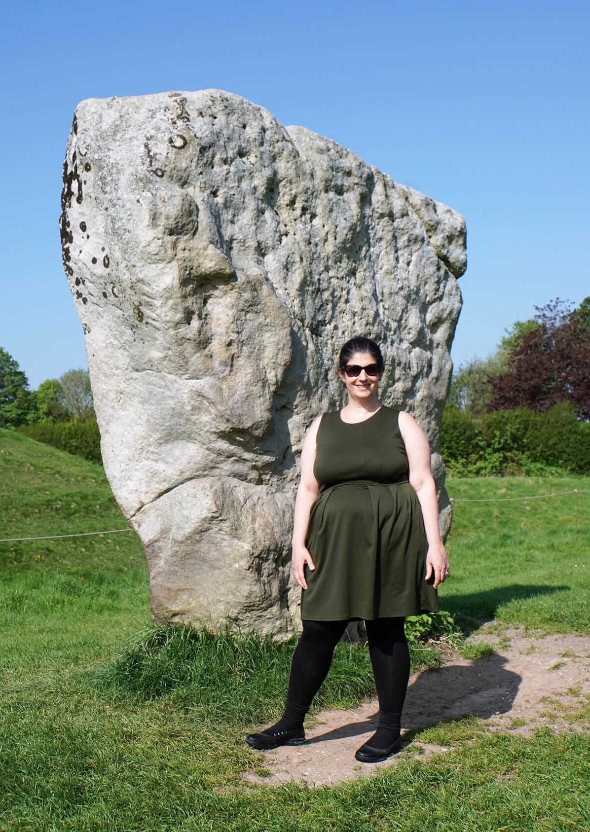 Anisa with one of the stones at the Avebury Stone Circle-
