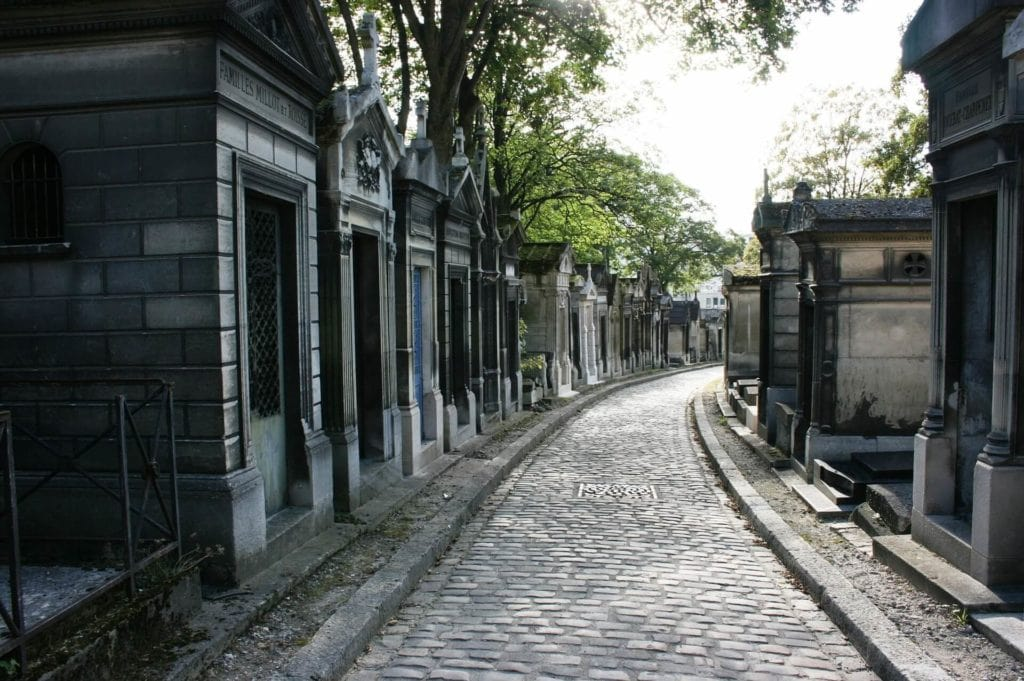 "Just one of the rows of mausoleums at Père-Lachaise Cemetery. - ""Paris Bucket List Ideas"" - Two Traveling Texans"