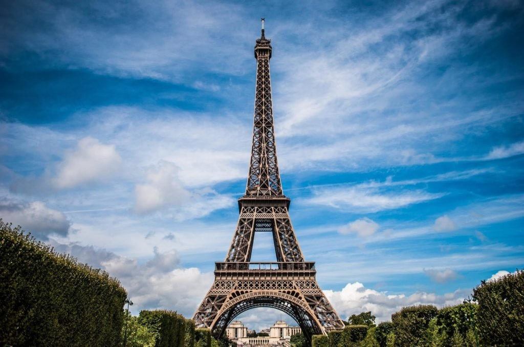 "Going to the top of the Eiffel Tower has to be on your bucket list! ""Paris Bucket List Ideas"" - Two Traveling Texans"