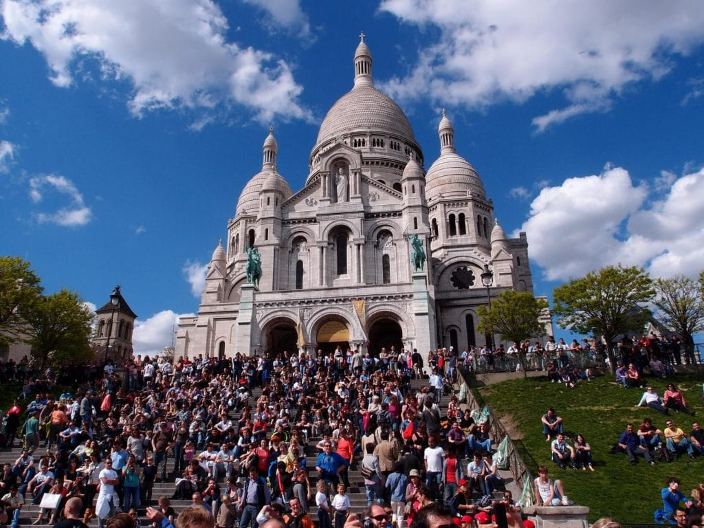 "The views are one of the reasons that people flock to Sacre Coeur. ""Paris Bucket List Ideas"" - Two Traveling Texans"