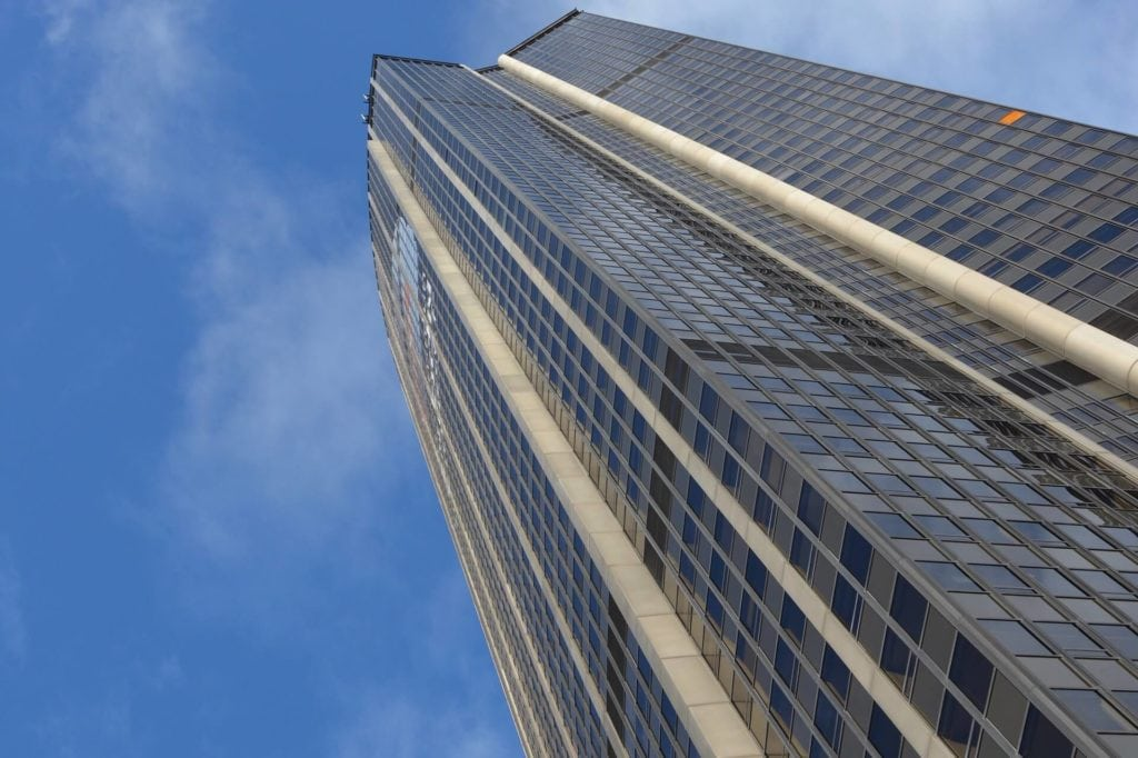 "Looking up Montparnasse Tower - ""Paris Bucket List Ideas"" - Two Traveling Texans"