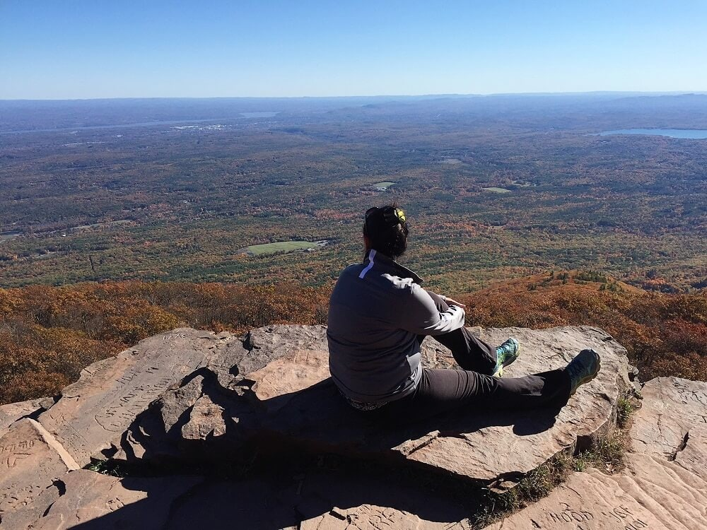 Anisa at the top of Overlook Mountain - The Best Hikes of the Hudson Valley
