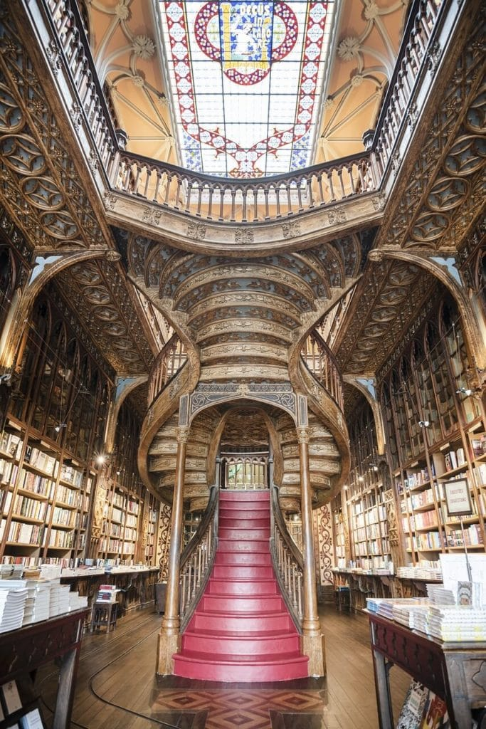 The stunning staircase inside Livraria Lello. - Harry Potter Porto Sites - Two Traveling Texans