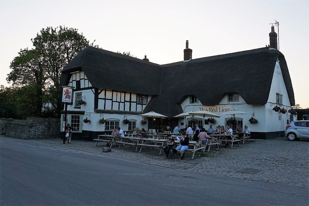 "The Red Lion Pub in Avebury is actually in the middle of the stone circle. - ""Avebury and Nearby Neolithic Sites in Wiltshire, England"" - Two Traveling Texans"