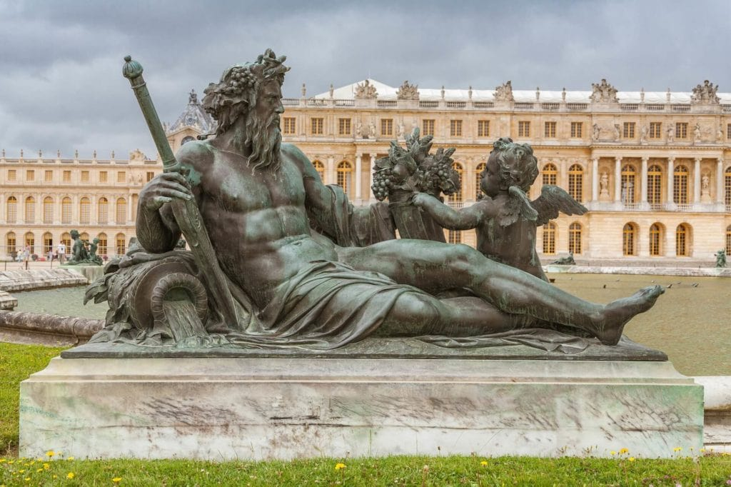 Statue and Palace of Versailles - Paris Bucket List - Two Traveling Texans