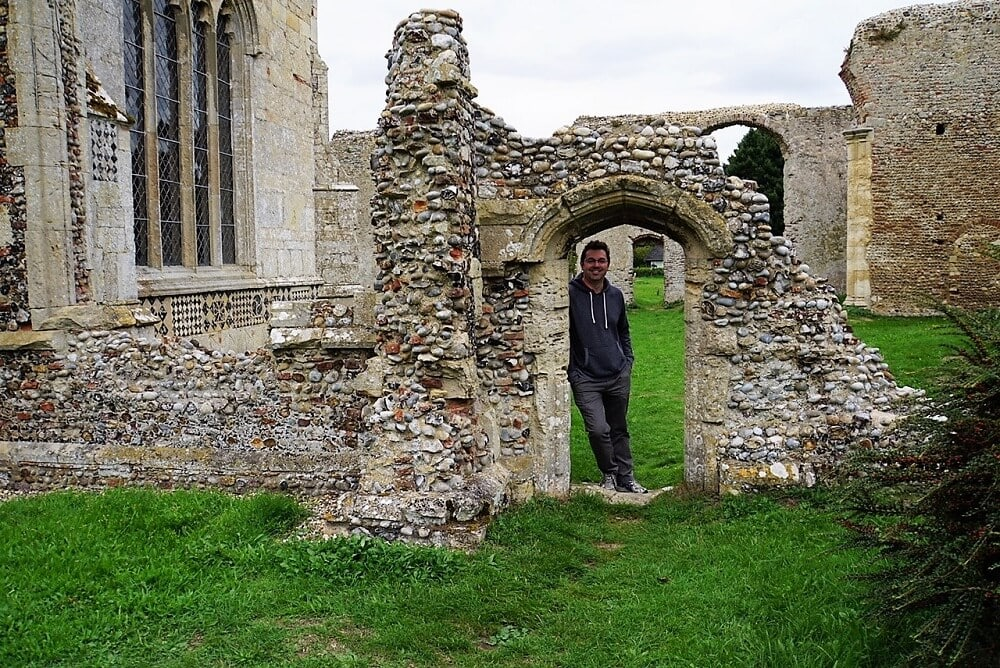 Russell in the doorway of the ruins of the old Walberswick Church. - Two Traveling Texans