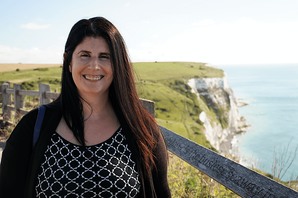 Anisa in Front of the White Cliffs of Dover - Dover Cliffs Guide - Two Traveling Texans