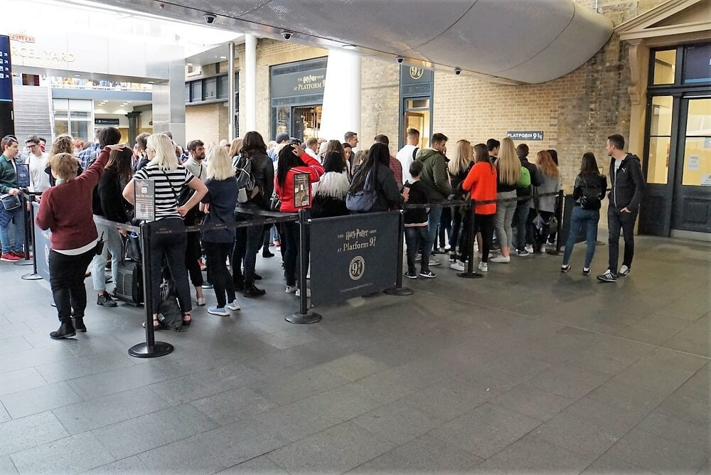 Line to take the Platform 9 3/4 photo - Harry Potter London Walking Tour - Two Traveling Texans