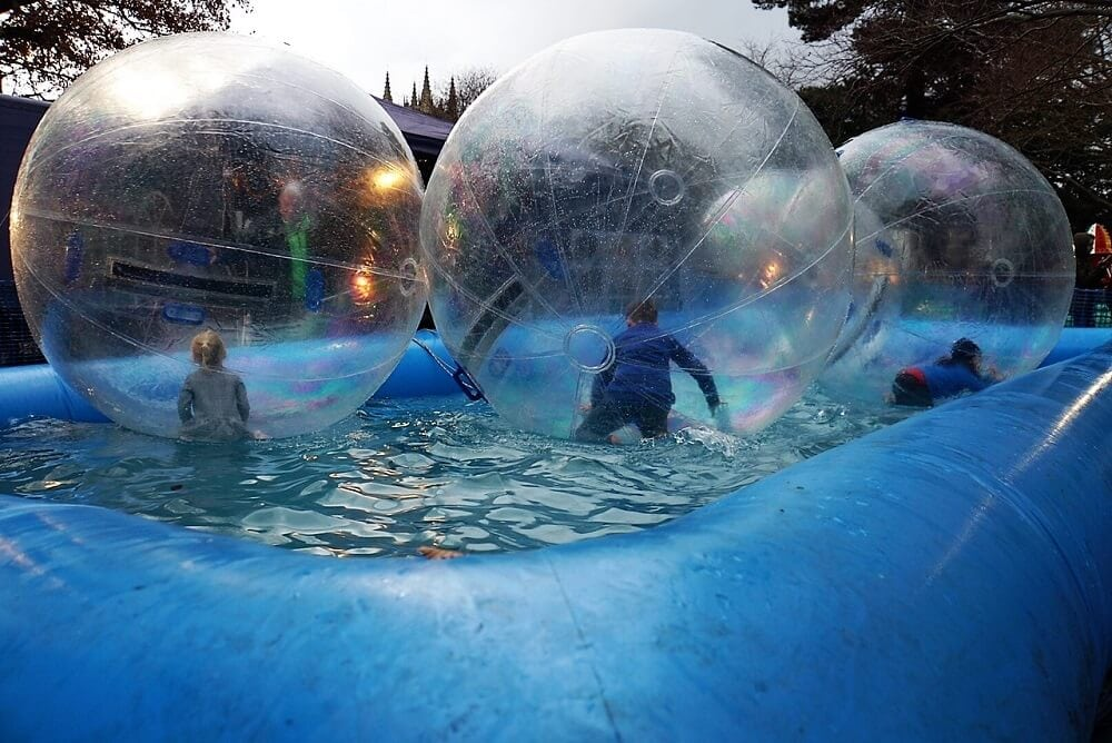 Kids were having a lot of fun inside these bubbles. - Kids Fun Fair at Bury St. Edmunds Christmas Market - Two Traveling Texans